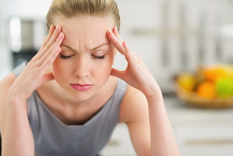 Woman suffering from headaches and migraines